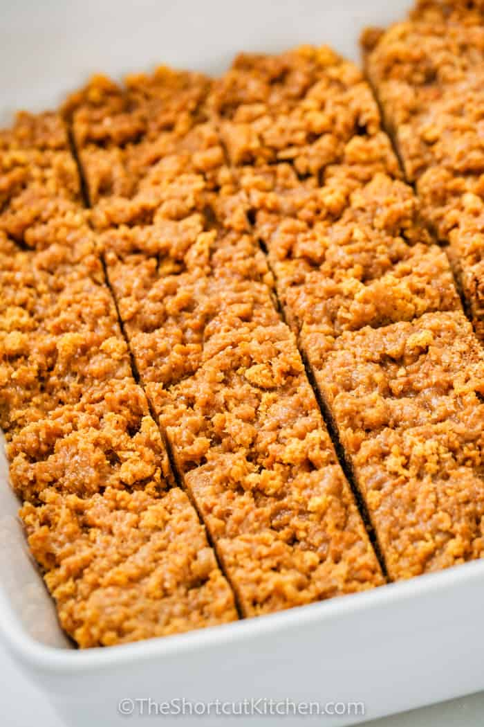 Cut up Peanut Butter Breakfast Bars in a white dish