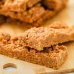 Peanut Butter Breakfast Bars in a pile on a wooden board