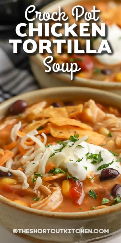 crock pot chicken tortilla soup topped with sour cream with text