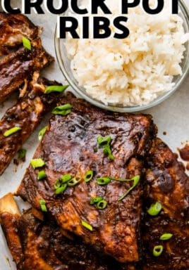Sweet & Spicy Crock Pot Ribs garnished with green onions and a side of rice with text.