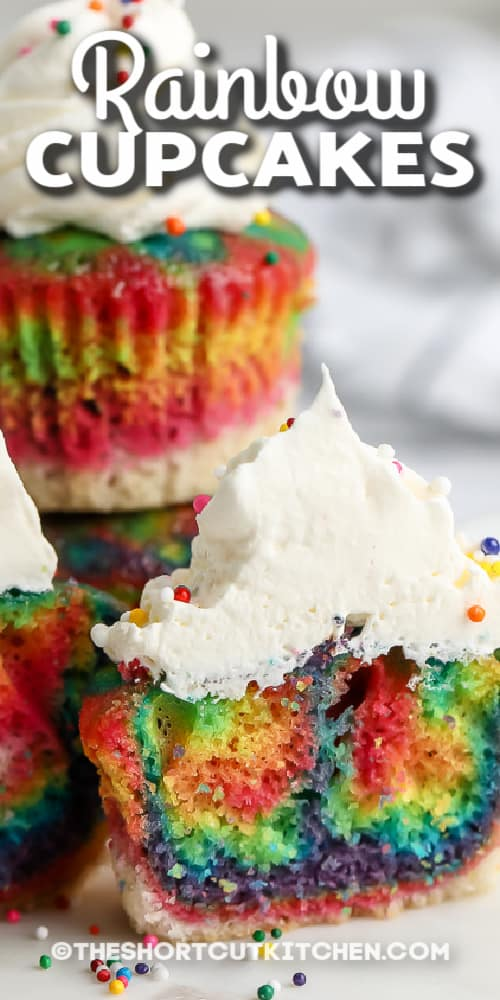 stack of rainbow coloured cupcakes with text