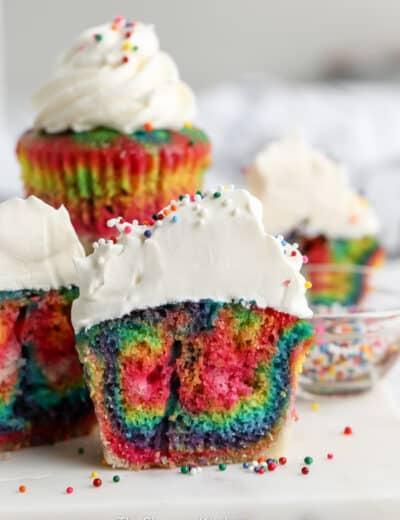 group of rainbow coloured cupcakes