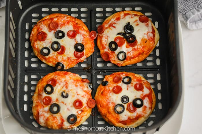 cooked Air Fryer Mini Pizzas in the air fryer