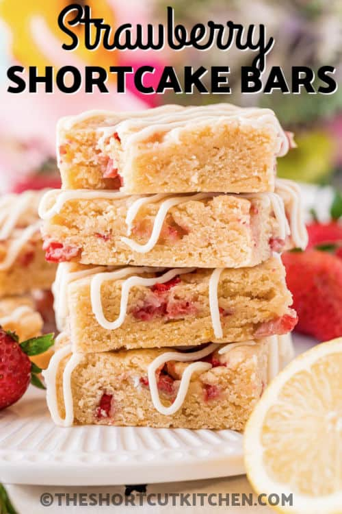 plated Strawberry Shortcake Bars with a bite taken out of one and a title