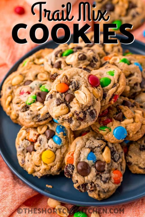 Trail Mix Cookies on a plate with writing