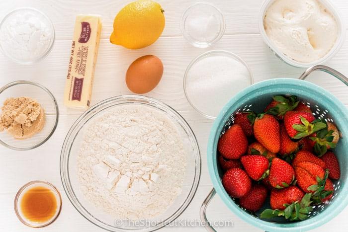 ingredients in bowls to make Strawberry Shortcake Bars