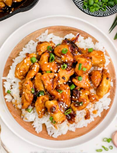 Sweet & Sour Chicken in a bowl with rice and green onions