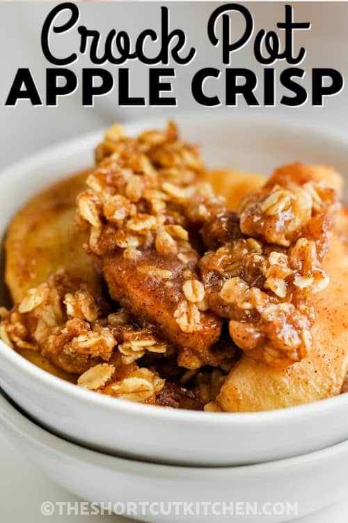 A bowl of crock pot apple crisp with text.