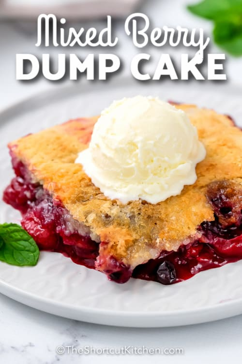 Mixed Berry Dump Cake topped with ice cream with text