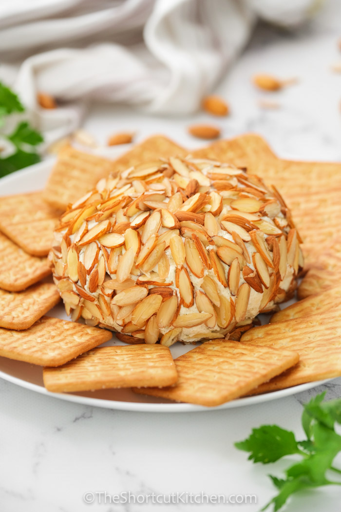 Parmesan Ranch Cheeseball with crackers on a plate