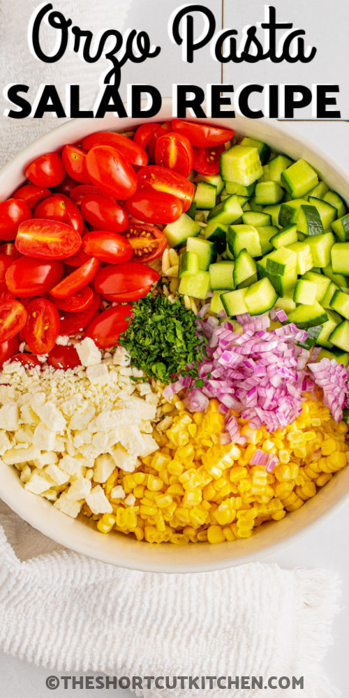 ingredients in a bowl to make an Orzo Pasta Salad with a title